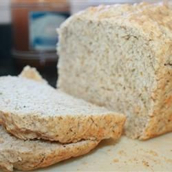 """Beer Bread I Allrecipes.com - Good basic recipe.  Used half wheat flour, half bread flour;  added 1 T baking soda, and pinch of salt in place of self-rising flour; used 3 T sugar; poured 2 T melted butter over top before baking.  Light """"cheap"""" beer works best if you don't want strong beer flavor, like Bud Light or similar."""