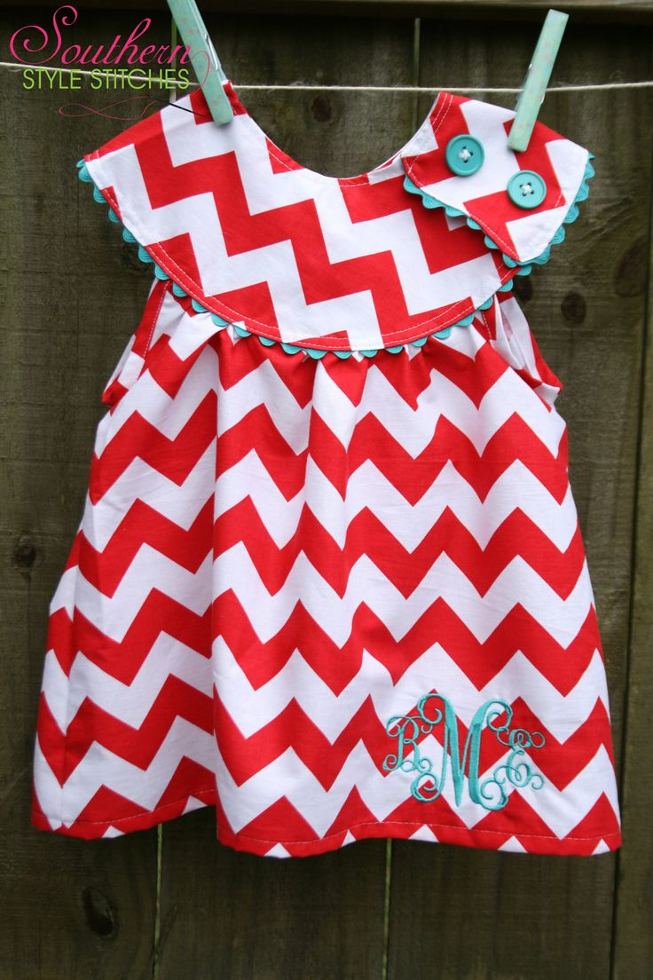 chevron, buttons, and a monogram