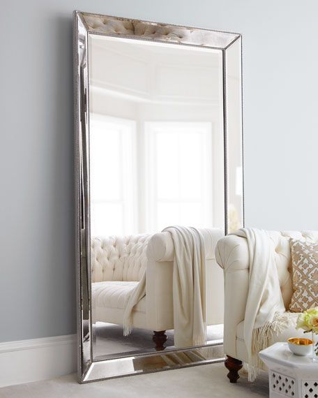 """Mirror-framed mirror. Frame is antiqued; mirror is beveled. Antiqued-silver beaded trim. 44""""W x 4""""D x 79""""T. Imported. Boxed weight, approximately 120.6 lbs."""