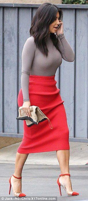 Kim Kardashian defies soaring temperatures wearing woolen skirt #dailymail