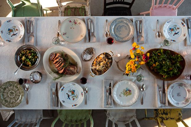 The Perfect Thanksgiving Dinner table! From the mismatched vintage chairs to the dishes, the whole thing- I want!