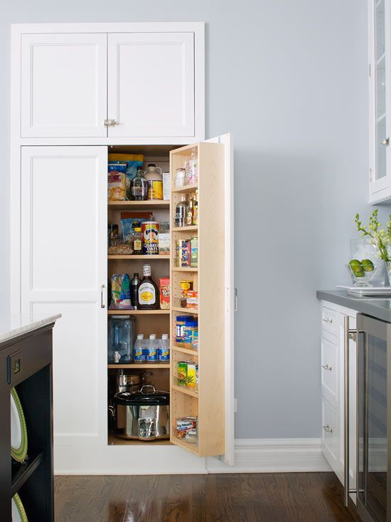 The built-in look of recessed-panel kitchen cabinets offers attractive, out-of-sight pantry storage. This recessed pantry design provides a combination of shelf and door storage for spices, dry goods, and small kitchen appliances.