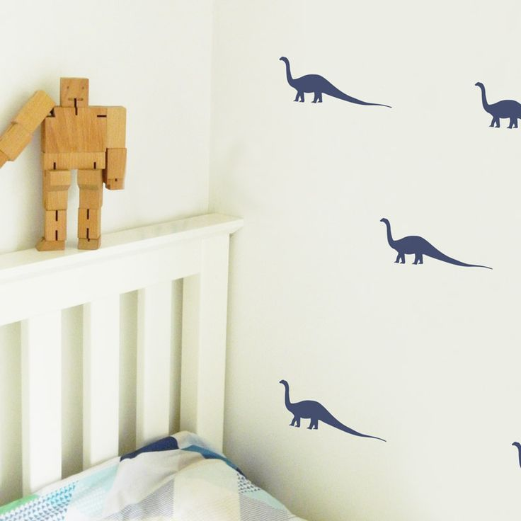 Do you have a kid that loves to ROAR!? Decorate their walls with these mini long necked dinosaur wall stickers. Great for little dino lovers! #dinosaurs #wallstickers #decor #kidsroom
