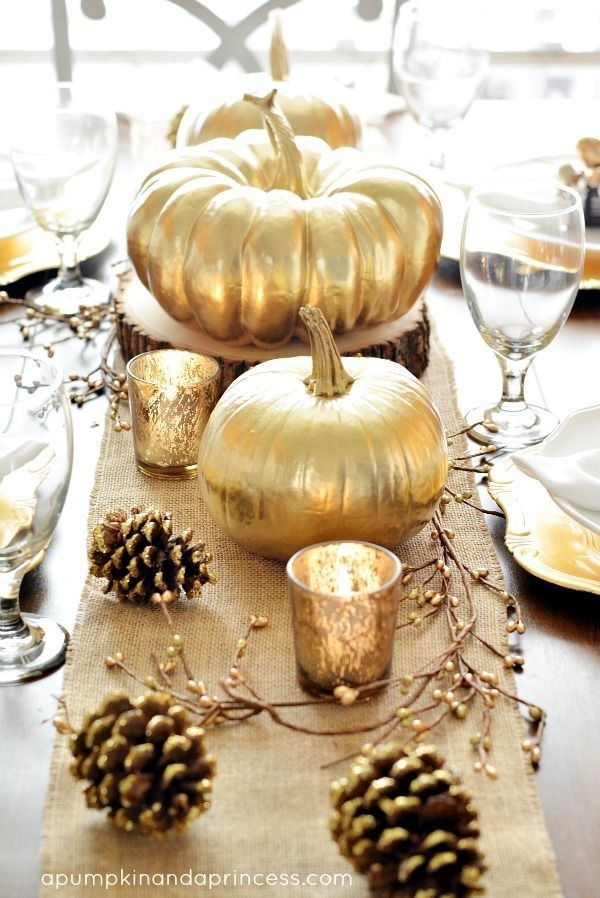 Gold Table Decor with Pumpkins and Pinecones on a burlap table runner {credit: A Pumpkin and a Princess}