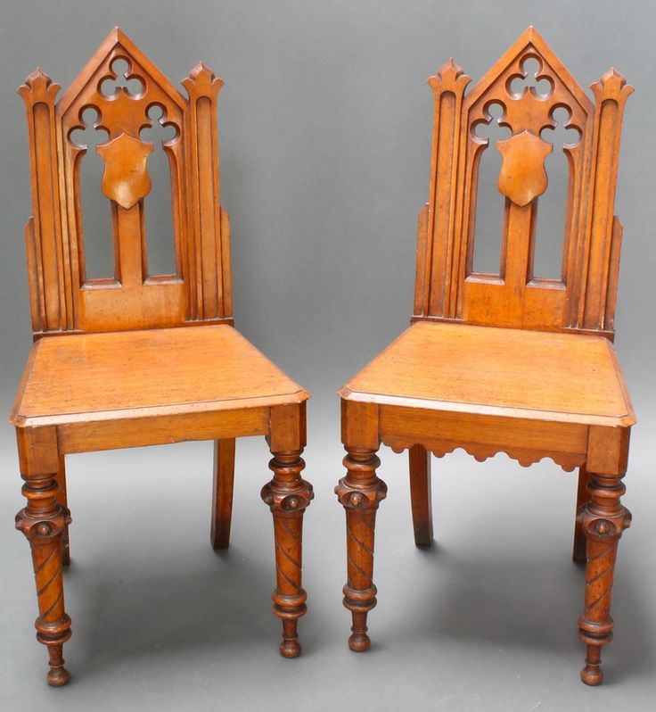Lot 945, A pair of Victorian light oak Gothic style hall chairs with pierced backs and solid seats, raised on turned supports est £160-190