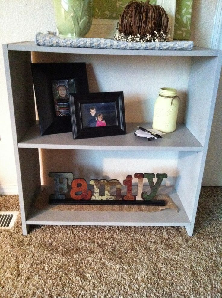 This drab particle board shelf was transformed by chalk for Shelf life of paint