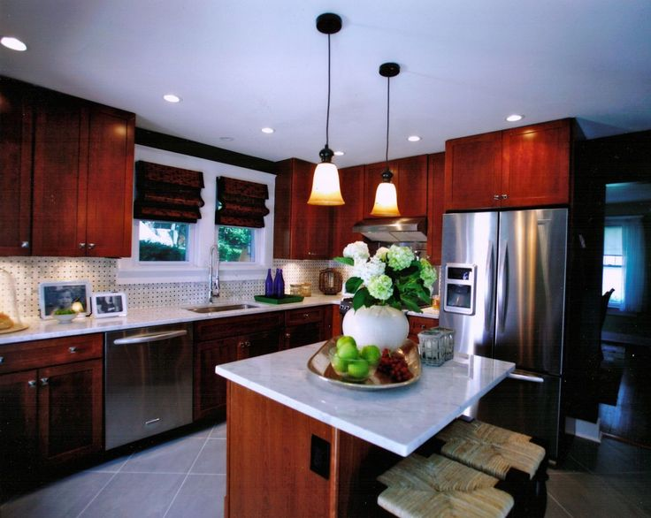 Modern Kitchen, Stainless Steel Appliances, Marble Counter Tops, Island  Seating, Tile Back