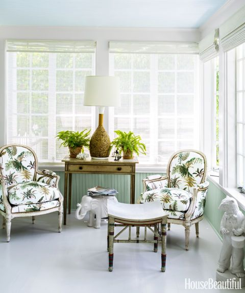 "GO BOLD – If you don't have the nerve to use a favorite pattern indoors, bring it outside instead. A Florida home's porch features chairs in an eye-catching botanical — ""a wonderful old pattern that Elsie de Wolfe used in the 1940s,"" designer Todd Romano explains. Click for the entire gallery and for more porch ideas."