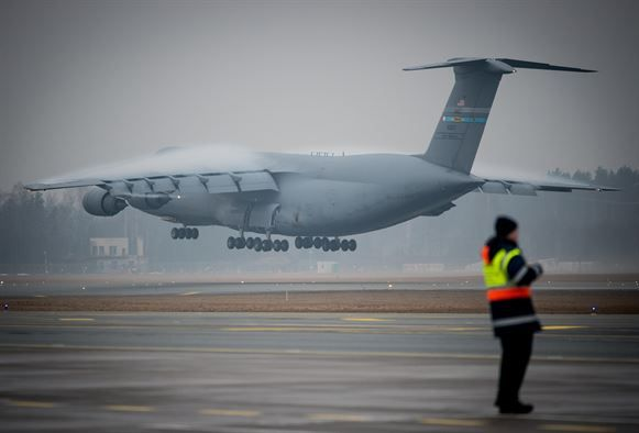 An Air Mobility Command C-5M Super Galaxy aircraft lands at Riga International Airport, Latvia, March 1, 2017, to deliver UH-60 Black Hawk helicopters for the U.S. Army in support of Operation Atlantic Resolve. Five Black Hawk helicopters will be deployed to Latvia as part of a larger contingent of helicopters and personnel deployed to support Operation Atlantic Resolve, a U.S. commitment to maintaining peace and stability in the European region. (U.S. Air Force photo/Tech. Sgt. Ryan Crane)