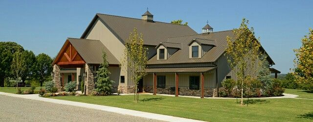 Tan exterior metal building greige brown roof different height buildings for second floor portico entry