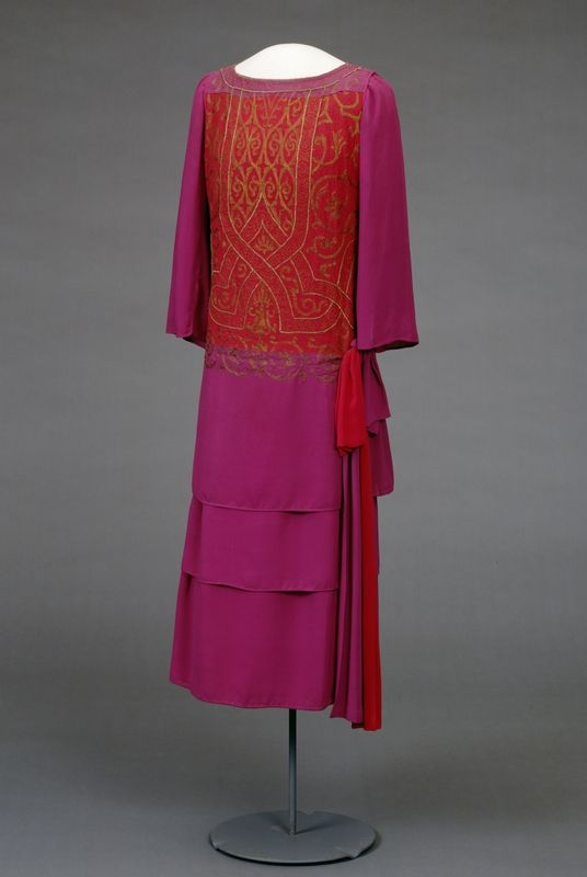"""Afternoon dress, 1923-24, at the National Museum of Art, Architecture and Design. According to the book """"Style and Splendor: The Wardrobe of Queen Maud of Norway 1896-1938,"""" Queen Maud may have worn this """"violet and tomato-red"""" dress on Midsummer Night's Eve in 1924 and on her birthday in the same year (pg. 51)."""
