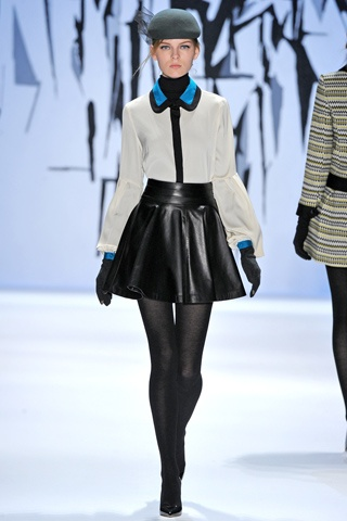 piped blouse, leather full skirt