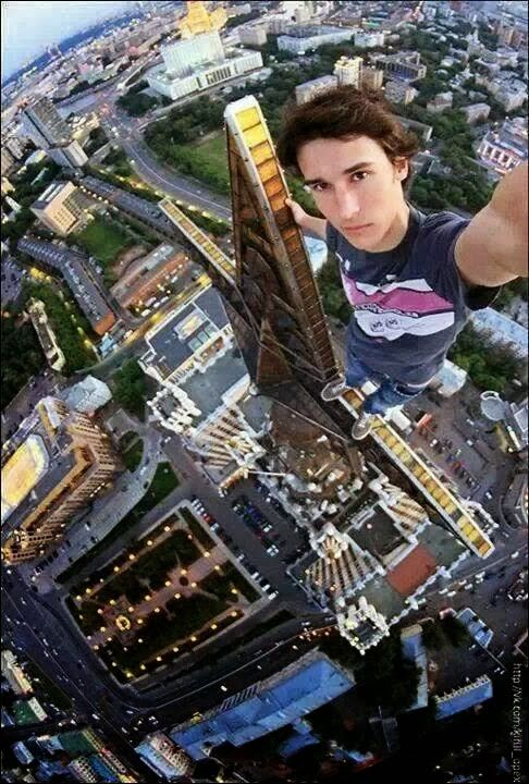 He climbs a signboard and makes a breathtakingly selfie