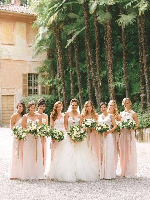 Model Chrissy Teigen's bridesmaids wore pale Amsale dresses at her wedding to musician John Legend in Lake Como