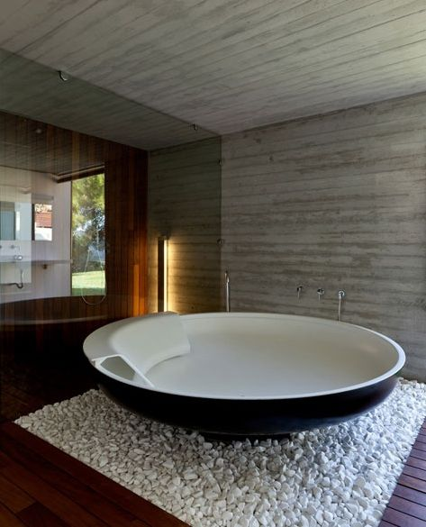 Teak floor, the use of glass, the pickled wood on the wall & ceiling... bath tub