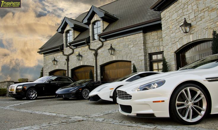 I don't think they have enough cars. Good thing they have a 4-car garage with plenty of space. See what wood garage doors cost.