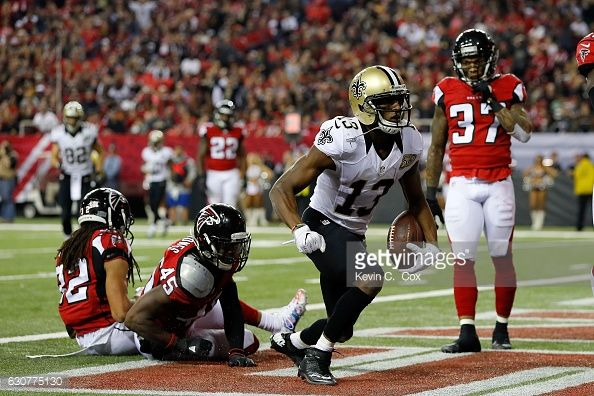 Michael Thomas of the New Orleans Saints celebrates a touchdown during the second half against the Atlanta Falcons at the Georgia Dome on January 1...
