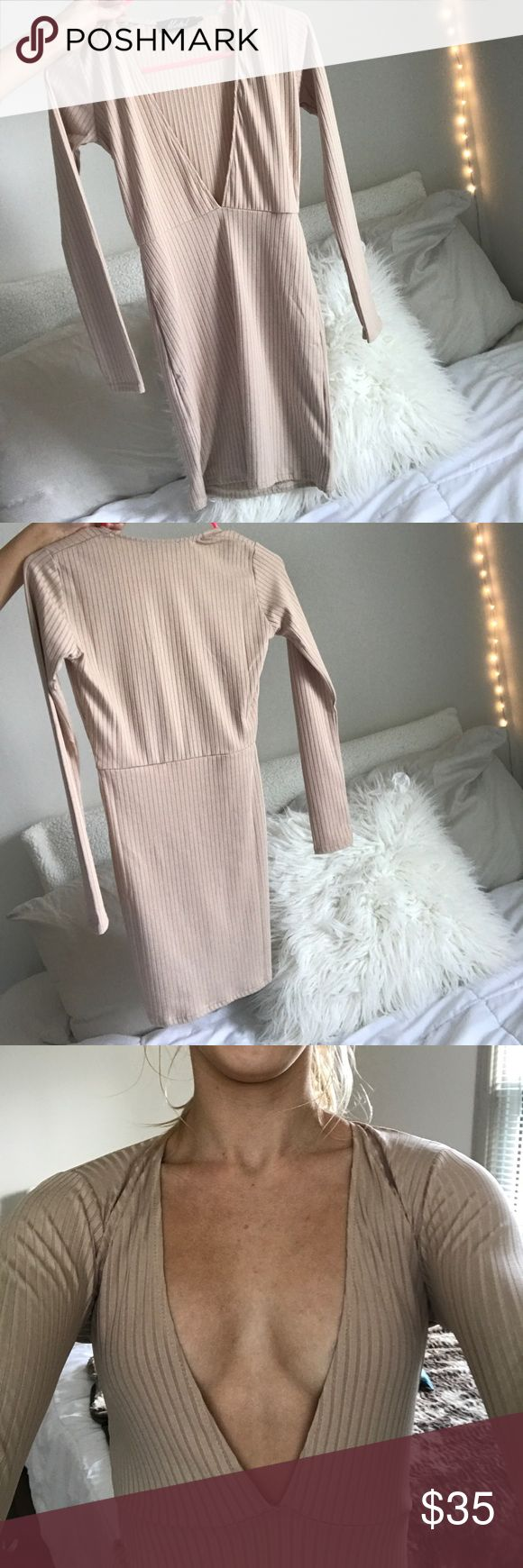"•never worn• deep v nude bodycon dress GORGEOUS nude dress that fits like a charm, ""holds the goods in"" and is extremely flattering for any figure. The reason I'm selling it is because I don't have any event I would wear it to! Motel Dresses Mini"