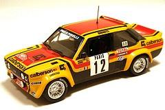 Fiat 131 Abarth - M. Mouton - Annie Arrii - 1980     O escorpião voador   A firma Abarth, cujo emblema é um escorpião, concebeu o 131, carro que teve uma longa carreira de cinco anos e alcançou uma vitória no Rallye Monte-Carlo de 1980, três títulos de marcas e um de pilotos.