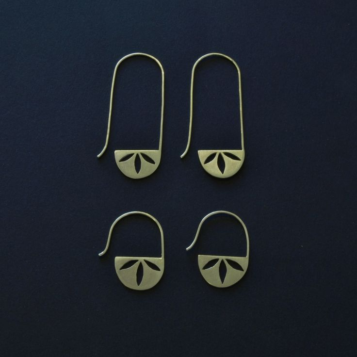 Silver earrings with saw pierced detail and hook. Available with a short or long hook. Great for wearing everyday.The Sol collection was originally inspired by the intricate patterns at the very centre of an Indian quilt. Dimensions: 1.3 x 4.5 cm approx                     1.3 x 2 cm approx
