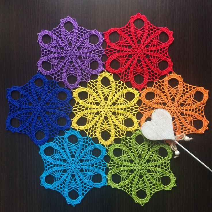 Handmade crochet doily with floral motif and rainbow colors