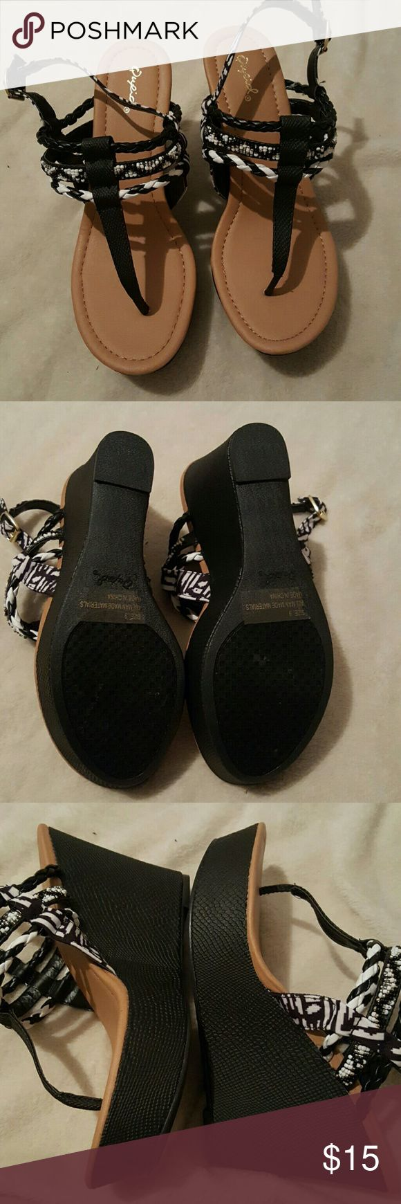 Brand new never worn. Great buy for the summer! Black and white wedge sandals. Shoes Sandals