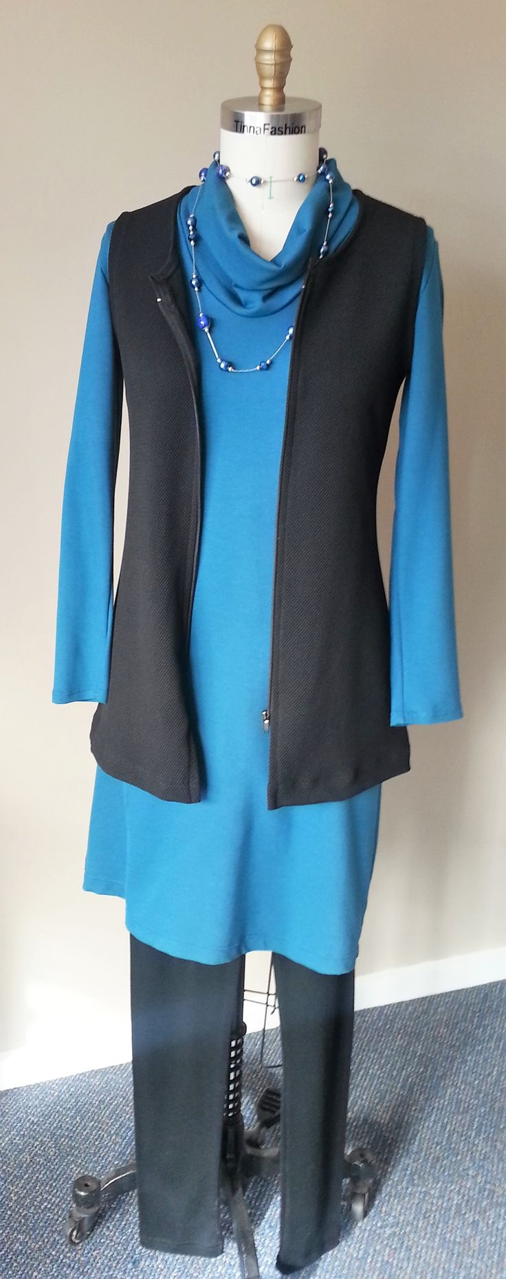 Classic Knit Dress in Teal Monty fabric, a pair of Pure Wool Leggings, and a Long Fitted Vest in Stretch Pique fabric