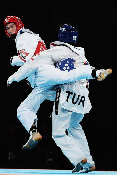 Servet Tazegul and Martin Stamper Photos - Martin Stamper of Great Britain competes against Servet Tazegul of Turkey during the Men's -68kg Taekwondo semifinal match on Day 13 of the London 2012 Olympic Games at ExCeL on August 9, 2012 in London, England. - Olympics Day 13 - Taekwondo