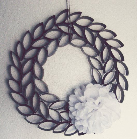 toilet paper roll wreath maybe spray paint rolls green and use a red bow for christmas