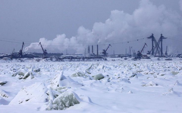 The Novoyeniseisk wood processing plant, on the bank of the frozen Yenisei River in the town of Lesosibirsk, some 300 km (186 miles) north of Krasnoyarsk, on January 31, 2013. The plant exports timber to Europe, Northern Africa and Asia.