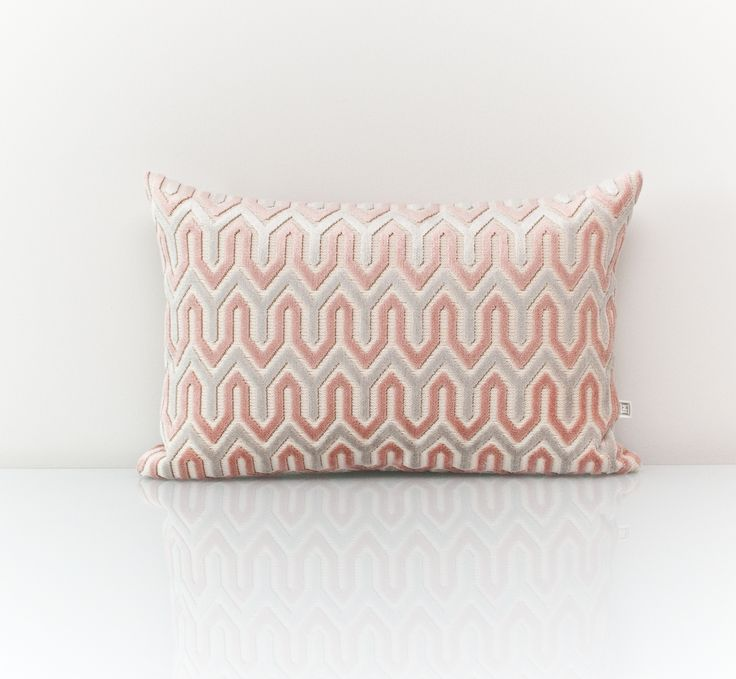 Grey pillow available at threadsandmore.ca Give a fresh look to your living room with this coral colored accent lumbar. Coral transitions with the seasons - In Spring and Summer, use alongside celery green while in Fall, keep the Coral and trade the other colours with warm ones like chocolate. The velvety texture gives this pillow an ultra-luxurious feel. Inspired by Pantone Spring Colour 2017-Pale Dogwood
