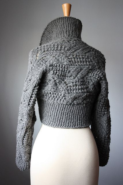 Beautiful design. Shrug knit from cuff to cuff, then stitches picked up for ribbing and shawl collar.  Gorgeous design!
