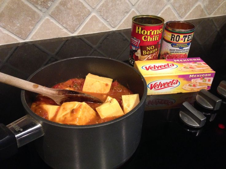 Chili cheese dip:  one can Hormel chili with no beans, one can Rotel Mexican style, and 16 ounce Mexican Velveeta.  Mix all together, bring to a boil, and serve with your favorite Tortilla Chips or Fritos.