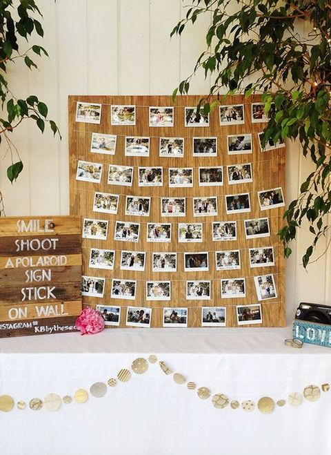 Polaroid picture guest book wall.