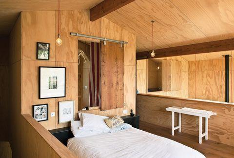 Minimalist mezzanine bedroom with French oak floorboards
