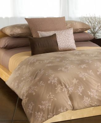 """Calvin Klein Home Queen Duvet Cover in Rice Grass by Calvin Klein. $129.00. 100% Pure Combed Cotton. 220 Thread. Machine Wash Cold with Similar Colors. One Calvin Klein Queen Duvet Cover in Rice Grass. Finished Size: 88"""" X 92"""" for 60"""" X 80"""" Mattress. A balmy breeze blows a smattering of creamy blossoms across a warm brown field. Asian-inspired patterns, deep hues and richly textured fabrics make Calvin Klein Rice Grass bedding an ensemble of tranquility."""