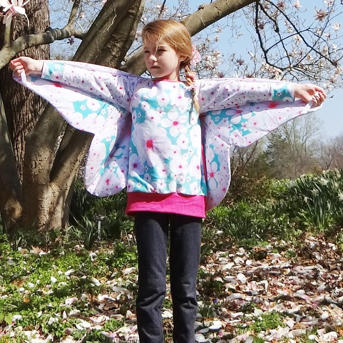 """The Vanessa Wing is a double-sided butterfly wing with an optional layer of fleece interfacing.  The wings are worn """"backpack style"""" with elastic shoulder and wrist straps.  The Vanessa Wing is perfect for active children who love imaginary play and creative adults who are young at heart.  .  These wings look adorable with a pair of jeans and casual tee or fancy them up with a tutu and accessories. They are perfect for tossing in the dress up box, the imaginary play cente..."""