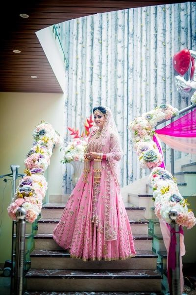 Bridal Wear - Pink and Gold Wedding Lehenga with Floral Decor | WedMeGood #wedmegood #indianbride #indianwedding #bridalwear #lehenga #pink #bridal
