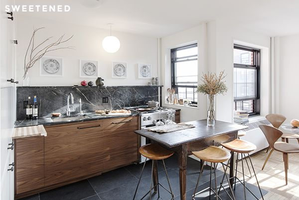 Casey and Kumar envisioned the kitchen as a central part of the main shared space of the apartment and found a number of ways to integrate prep and cooking utility without making visual intrusions into the dining and living area.