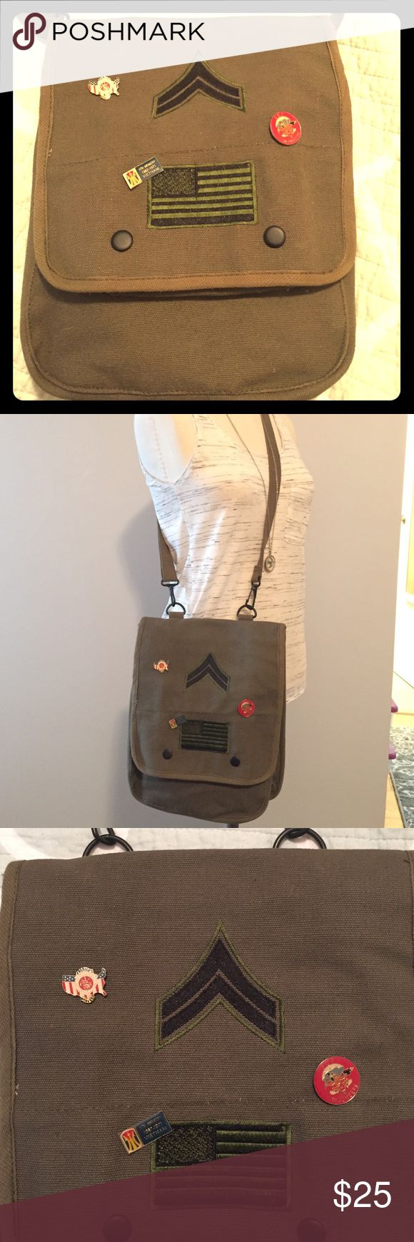 """Military Chic- cross body bag Authentic military cross body bag.  Makes a super cute purse!! Olive green canvas with authentic military patches and pins on front.  Adjustable woven strap measuring 44"""" in total length.  Fold over flap closure with double snap.  One large interior pocket and one smaller front pocket with elastic holders (great for pens/lipgloss).  Purse is 10"""" high, 8"""" across, 4"""" width.  Excellent condition, purchased at military supply store but never used.  No trades. Bags…"""
