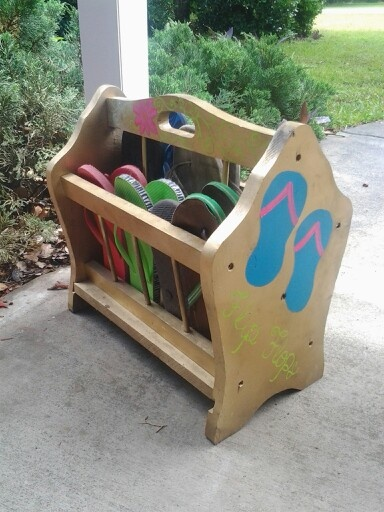 I found a magazine rack at a yard sale, painted it (with a friend's help) & transformed it into a flip flop caddy.