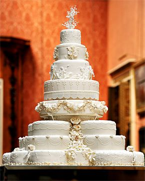 Prince William and Duchess Kate's wedding cake - a traditional multitiered fruitcake with cream and white piping designed by prestigious British baker Fiona Cairns.