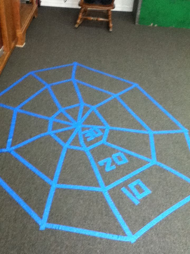 Create a web with point values on the floor with tape and have children toss a bean bag. Use painter's tape, it will not leave a residue on carpet or tile when it is pulled up.