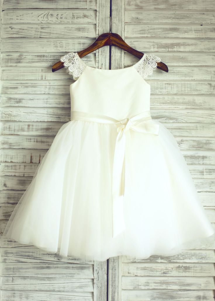 The dress is made of high quality satin/tulle/lace fabric.Delicate lace cap sleeves,modest neckline, puffy tulle skirt with detachable sash. The listed is ivory color.This dress is perfect for wedding,Easter or baptism.For Custom Dress, please enter the measurements at Custom Note Box which you will