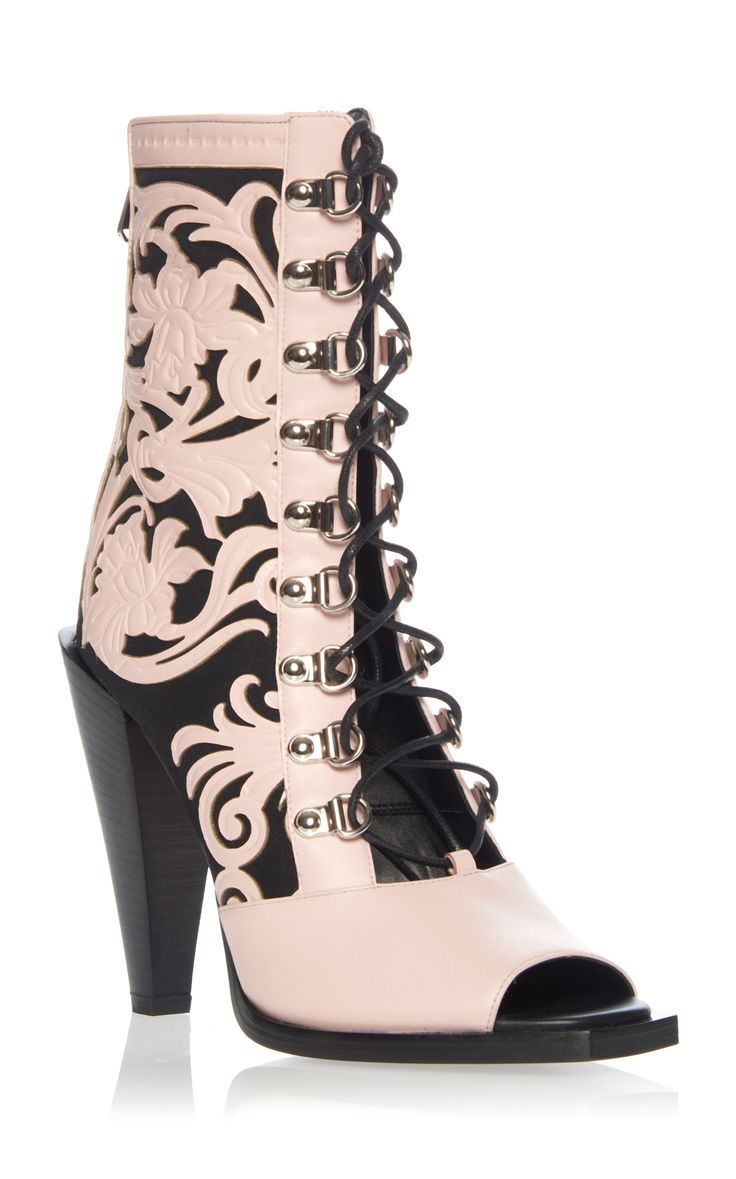 This **Balmain** boot is rendered in leather and features a laser cut  pattern and metal detailing.