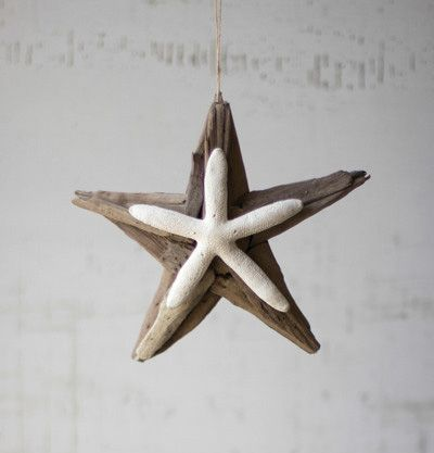Driftwood and Natural Starfish Ornament. Salvaged pieces of natural driftwood are arranged by hand to create the star design. Natural finger starfish takes center stage in this hand-made Christmas ornament. Each will be unique by nature.