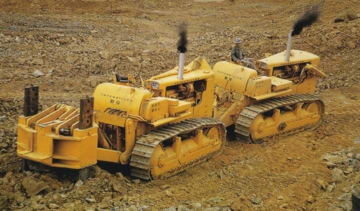 rollerman1:  Two Caterpillar D9G's with a Peterson kit working in tandem as one ripping.