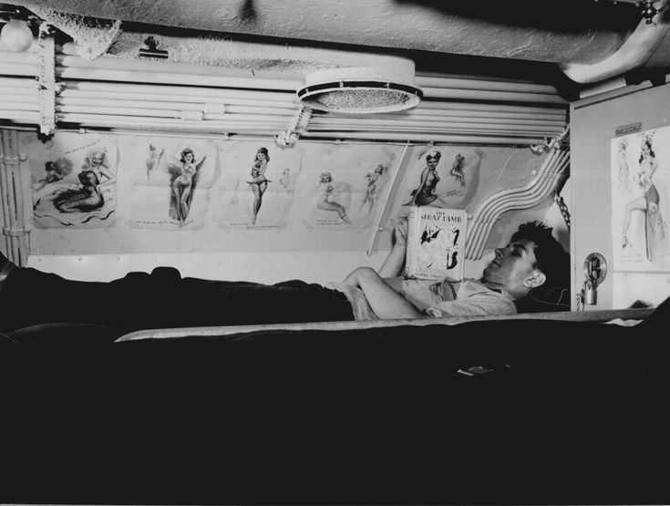 """Sailor reading in his bunk aboard USS CAPELIN at submarine base New London, Conn."" Lt. Comdr. Charles Fenno Jacobs, August 1943."
