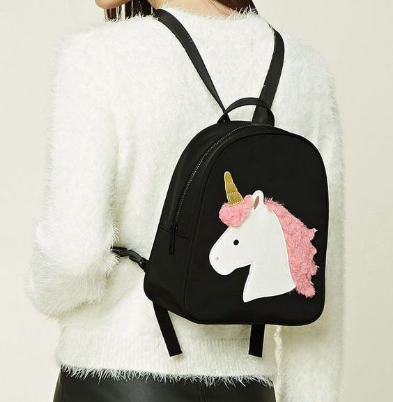 A fuzzy unicorn graphic backpack that you'll want to pet for days. | 33 Of The Cutest Accessories You've Ever Seen