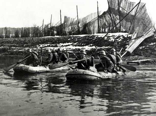 1940, German soldiers crossing a river in inflated dinghies on the western front, Germany's victory in France in 1940 followed the 'Phoney War, (September 1939-April 1940) and the German breakthrough accomplished at great speed meant France was forced to surrender in June 1940 - pin by Paolo Marzioli